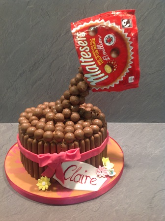 A Unique 57th Birthday Cake Maltesers Being Poured